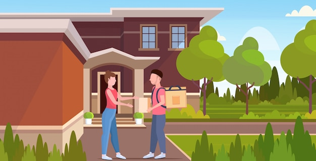 Woman receiving order from man courier with backpack and paper package express food delivery from shop or restaurant concept modern house building exterior  horizontal full length