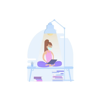 Woman relaxing in lotus position, working from home or office on quarantined masked tablets, as well as reading news about the economy or coronovirus ..