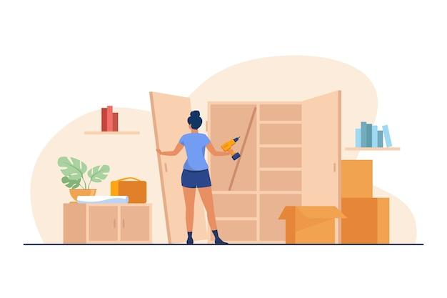 ハンドドリルでワードローブを修理する女性。ドア、木、アセンブリフラットベクトルイラスト。家具とリフォームのコンセプト