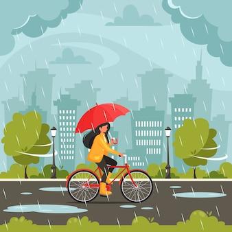 Женщина, езда на велосипеде под зонтиком