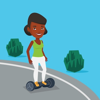 Woman riding on self-balancing electric scooter.