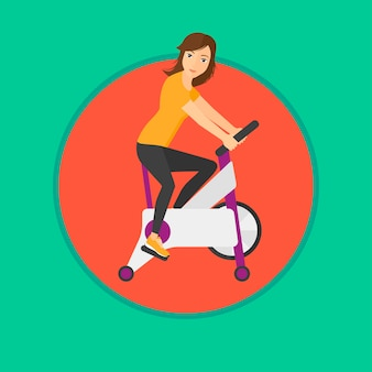 Woman riding stationary bicycle.