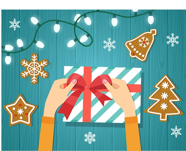 女性の手は赤いリボンで紙に包まれたクリスマス休暇の手作りプレゼントを与えます。ベクトルイラスト。