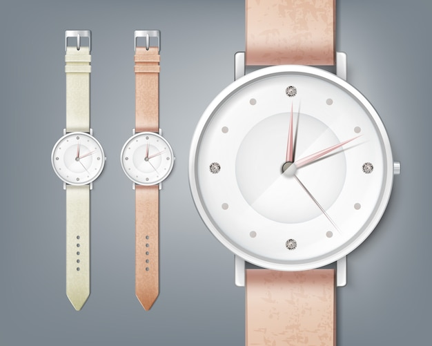 Woman's watch with gem, isolated close up on gray background