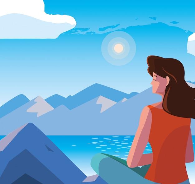 Женщина сидит, наблюдая пейзаж с озером
