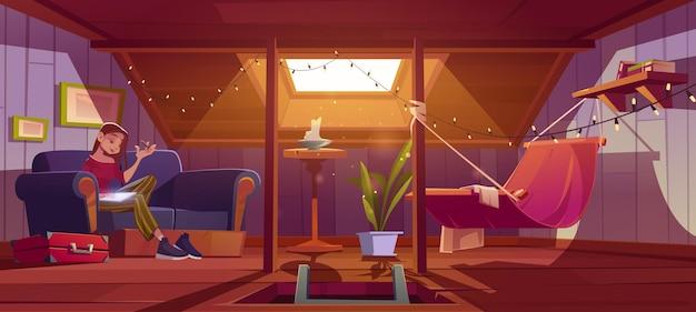 Женщина сидит с планшетом на диване в уютной комнате на чердаке