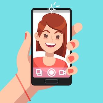 女性の自撮り。スマートフォンでセルフ写真の顔の肖像画を取っている美しい女の子。電話カメラ中毒漫画コンセプト
