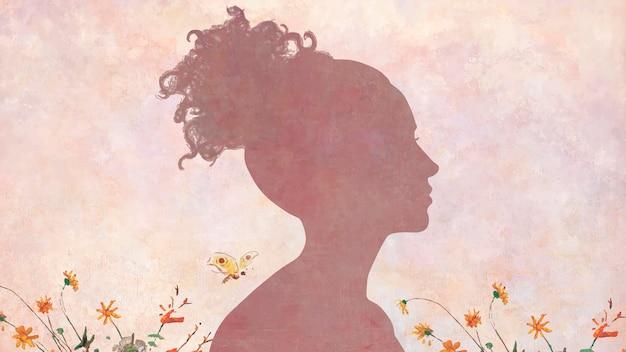 ピンクの絵の背景に女性の影