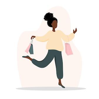 女性の買い物。バッグを運ぶ幸せな女の子。