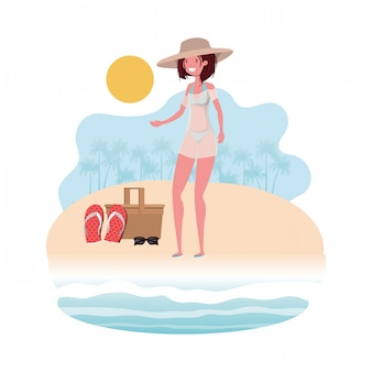 Woman on the shore of the beach with picnic basket