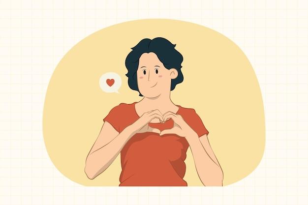 手で形のハートを示す女性ハート形のサイン