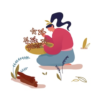Woman sitting on ground with bowl in hands collecting herbs and flowers in forest or garden for herbal medicine or cooking.