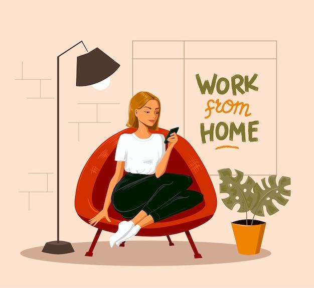 スマートフォンを見ている椅子に座っている女性