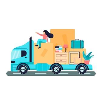 トラックの上に座って家を移動する女性