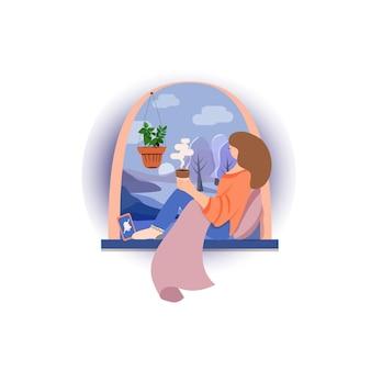 自宅の窓辺に座ってお茶やコーヒーを飲む女性。黙って時間を過ごしてください。