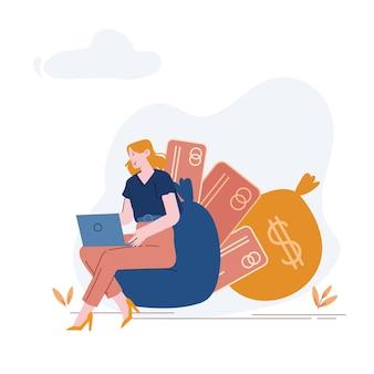 Женщина, сидящая на стуле с кредитными картами