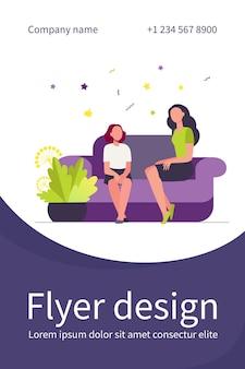 Woman sitting on sofa with girl
