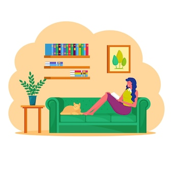 Woman sitting on sofa with tablet pc.  freelancer works from home