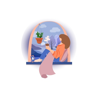 Woman sitting on a windowsill at home and drinking tea or coffee. spend some time in silence.