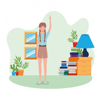 Woman standing in the living room with books