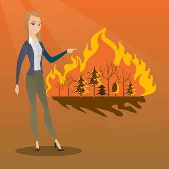 Woman standing next to wildfire.