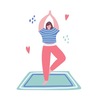 Woman stands in yoga pose on mat