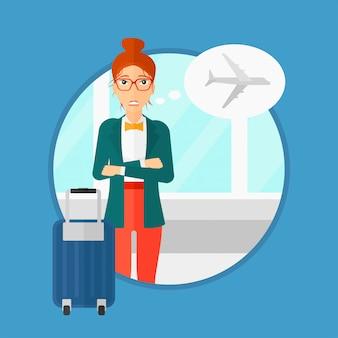 飛行の恐れから苦しんでいる女性。