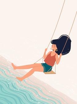 Женщина качается на качелях у моря