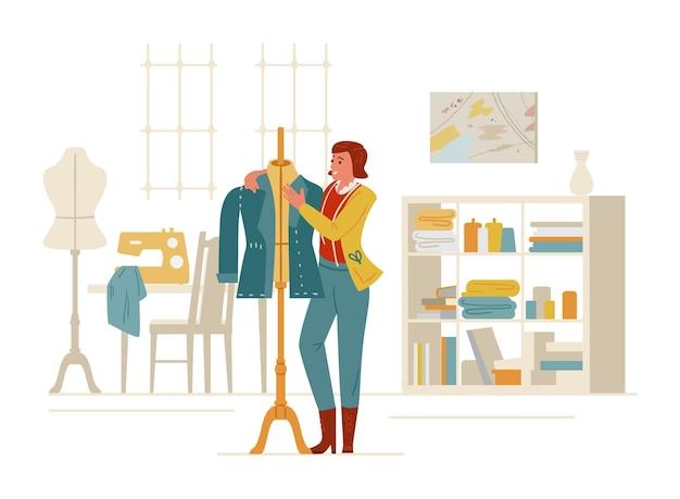 縫製スタジオのインテリアのマネキンの近くの女性の仕立て屋またはファッションデザイナー