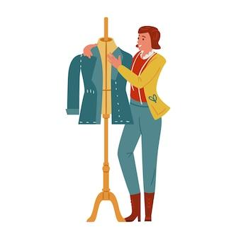 재킷을 만드는 마네킹 근처의 여성 재단사 또는 패션 디자이너