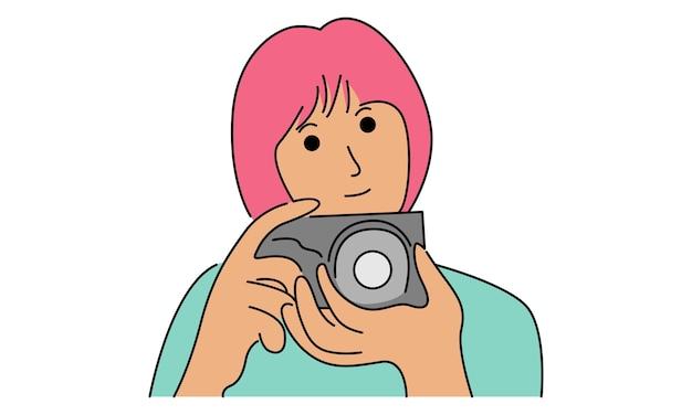女性はデジタルカメラで写真を撮る