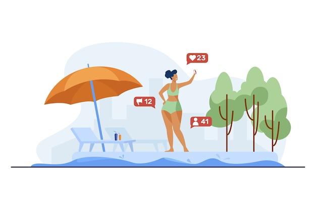 야외 수영장 근처 셀카를 복용하는 여자.