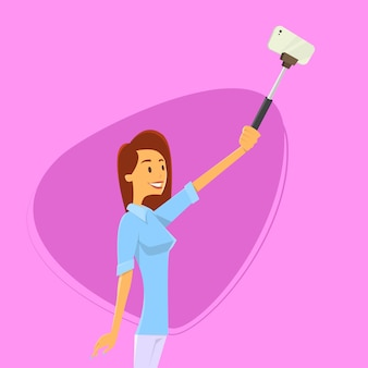 Woman taking selfie photo on smart phone with stick