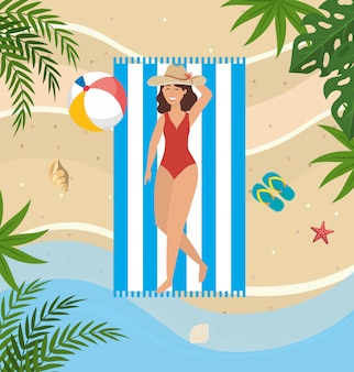 Woman taking sun with hat and beach ball in the towel