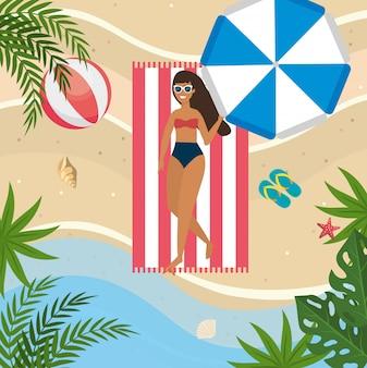 Woman taking sun with umbrella and beach ball