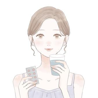 タブレットタイプの薬を服用している女性。白い背景に。