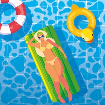 Woman tanning in float on the pool