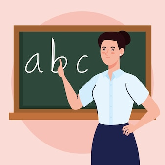Woman teacher with chalkboard in classroom