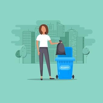 女性は有機性容器にゴミを投げます