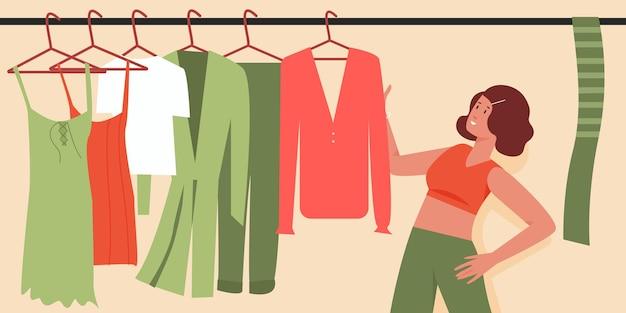 何を着るかを決める朝の女の子のワードローブの服を選択しようとしている女性