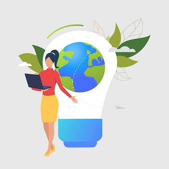 Woman using laptop, light bulb, earth globe and green leaves