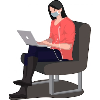 A woman using medical mask listening music from her laptop