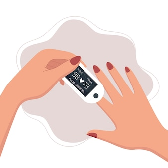 Woman using pulse oximeter device on finger