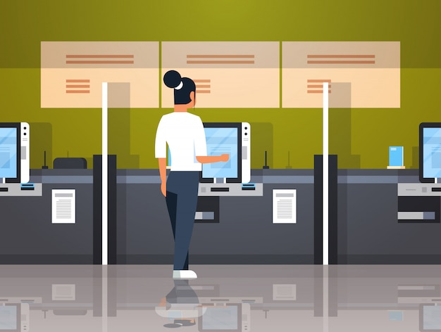 Woman using self service machine