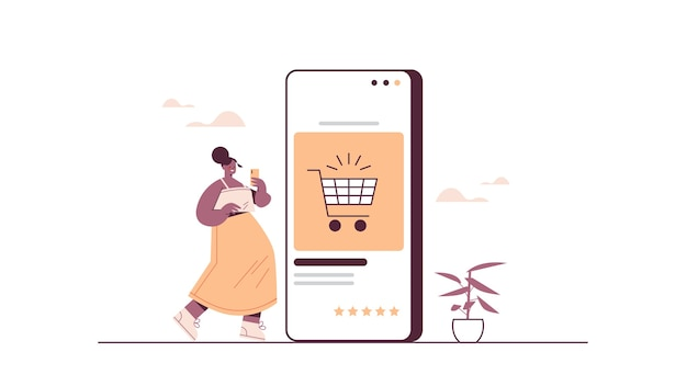 スマートフォンを使用してオンラインストア販売消費者のオンラインショッピングeコマーススマート購入で物事を購入する女性