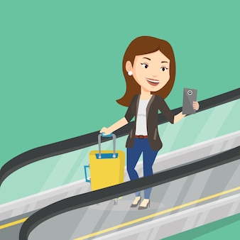 Woman using smartphone on escalator in airport.