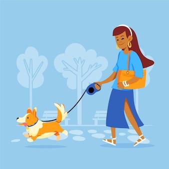 屋外の犬の散歩の女性