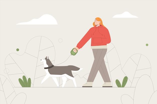 애완 동물 강아지와 함께 산책하는 여자