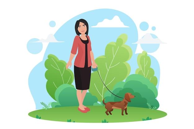 공원에서 작은 개 애완 동물과 함께 산책하는 여자