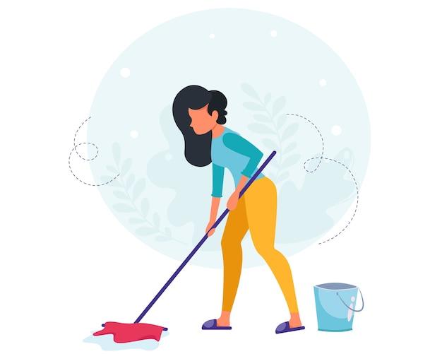 床を洗う女。ハウスクリーニングのコンセプト。主婦が家を掃除します。